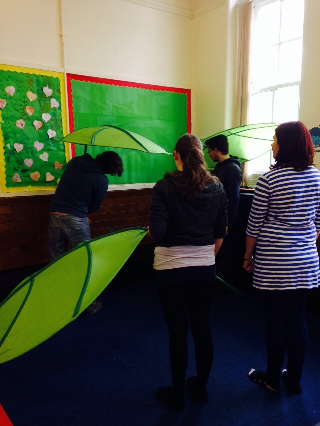 It's a team effort to install the reading corner's canopy