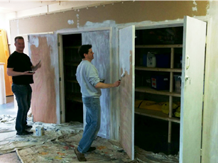 Paul and Stephen painting the newly-installed storage units